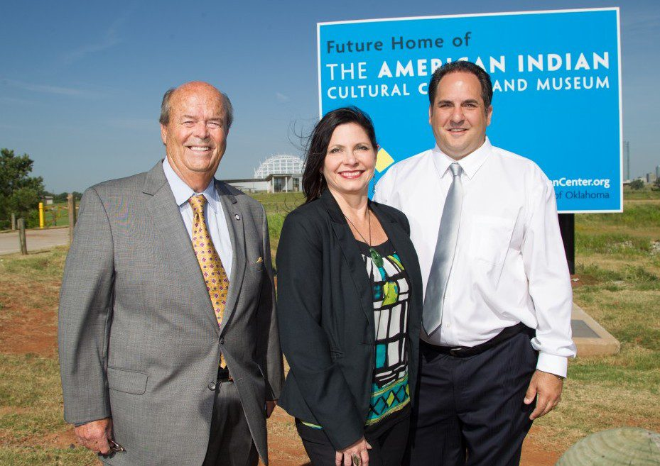J. Blake Wade, executive director of AICCM; Shoshana Wasserman, director of communications and cultural tourism; and Sen. Kyle Loveless R-Oklahoma City) stand at the partially finished site of the American Indian Cultural Center and Museum.