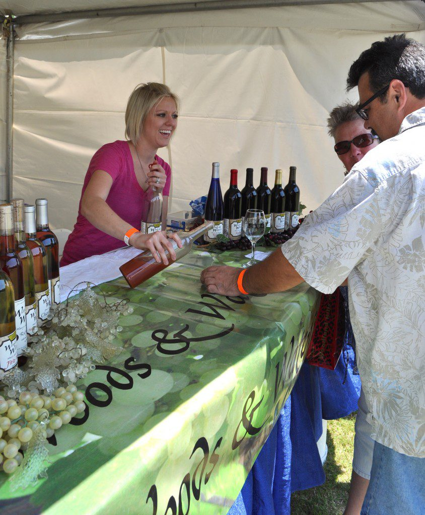 A representative of Woods & Waters Winery and Vineyard in Anadarko pours wine samples at last year's Made in Oklahoma Wine, Beer and Food Festival. Photo courtesy Midwest City Convention & Visitors Bureau.