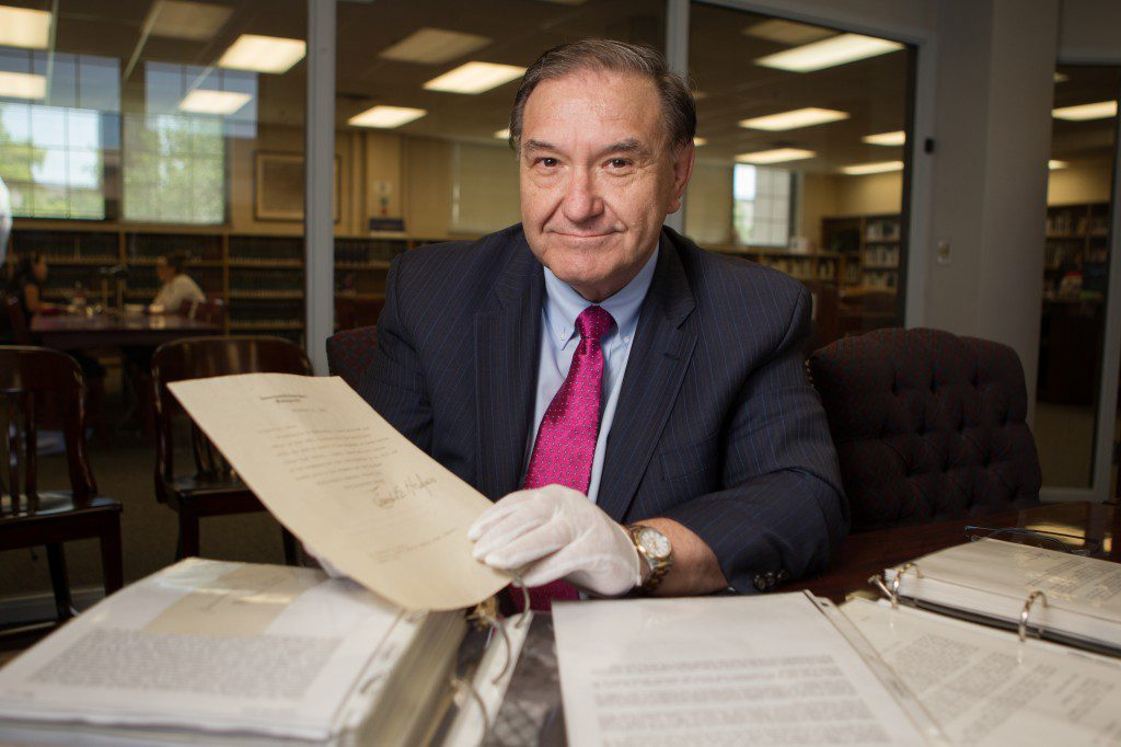 Oklahoma City attorney and life-long collector Bob Burke shows off part of his collection of U.S. Supreme Court justice signatures, housed at the Oklahoma City University college of Law. Photo by Brent Fuchs.