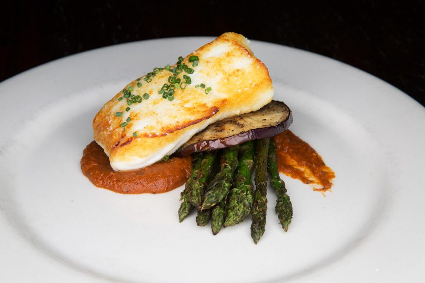 Lucky's Restaurant's roasted halibut with grilled eggplant and asparagus on top of a Romesco sauce is an explosion of flavor. Photos by Brandon Scott.