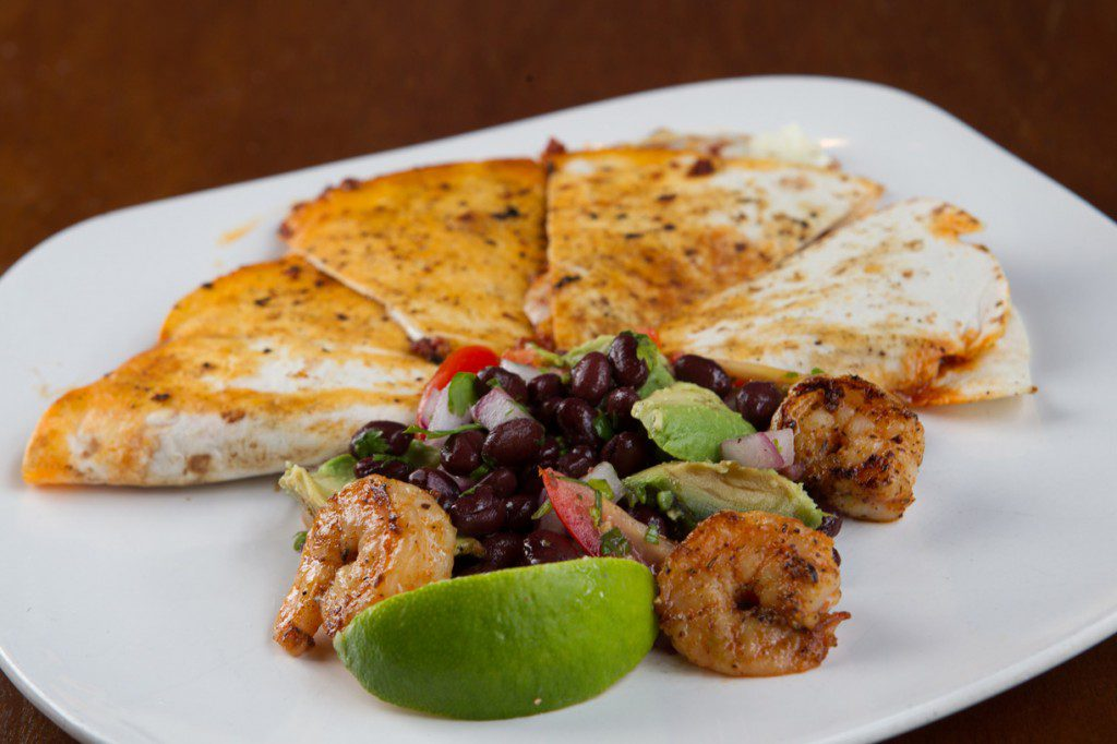 Take a big bite of the chorizo quesadilla with shrimp, an appetizer at Urban Roots. Photo by Brent Fuchs.