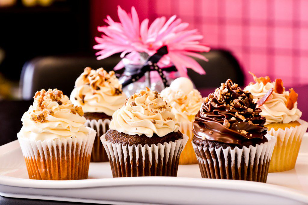 Sheila Hulsman offers up to 20 cupcake flavors – including Bringing Home the Bacon, Snow White's Delight, Slow Poke, Sin Is In, Peanut Butter Surprise and 24-Carrot Baby – at her bakery, Not Your Grandma's Cupcakes. Photo by Natalie Green.