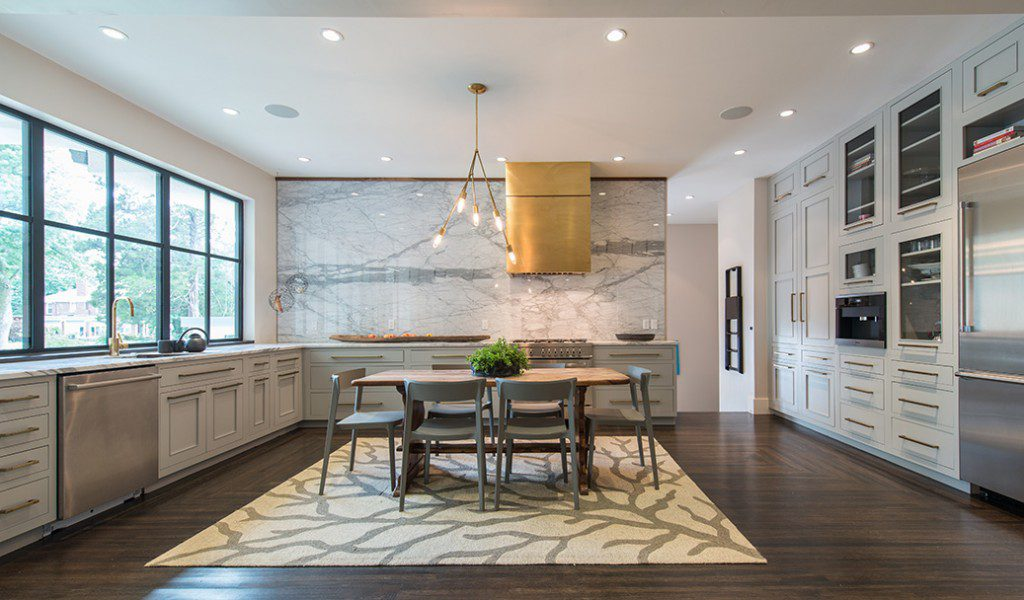 The centerpiece of the kitchen is a ceiling-high backsplash that was added to use up marble slabs. Photo by Nathan Harmon.