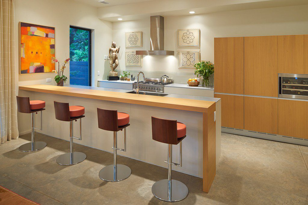 the clean lines in the kitchen design take their cues from the home's architect, david Wanzer.  Photo by David Cobb.