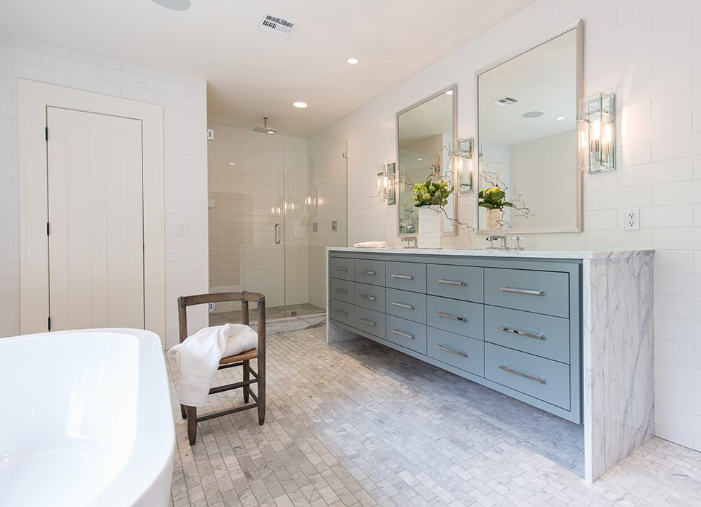The large, custom designed vanity is topped with Statuario marble in a waterfall design. Photo by Nathan Harmon.