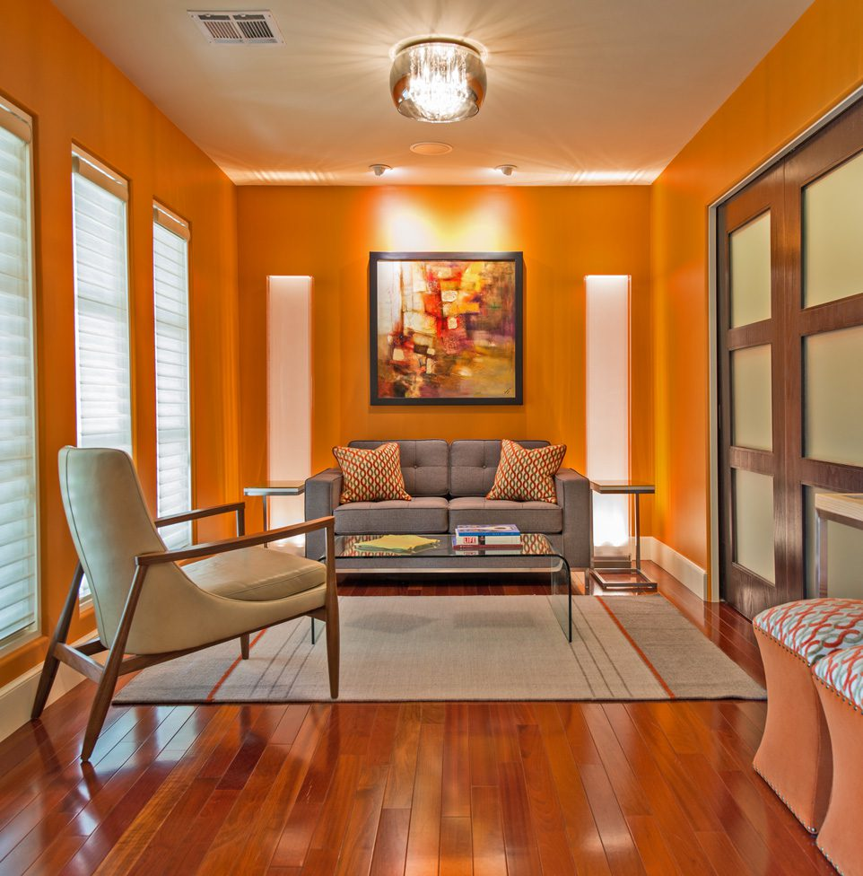 The sitting area in the study features a custom loveseat and leather-covered accent chair.
