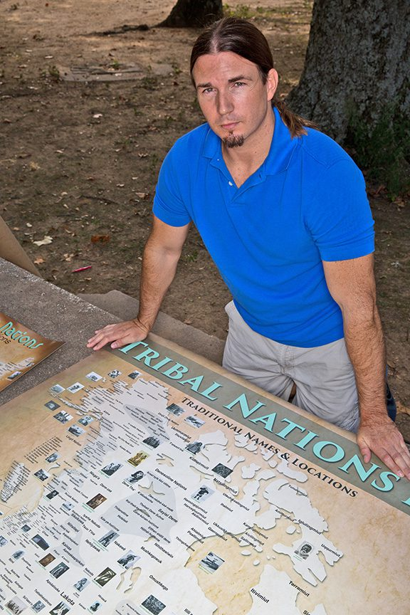 Aaron Carapella creates maps showing the locations of indigenous peoples prior to European colonization. Photo by Brandon Scott.
