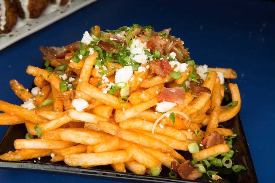 Buffalo fries are topped with buffalo sauce, bleu cheese, bacon and green onions. Photo by Brandon Scott.