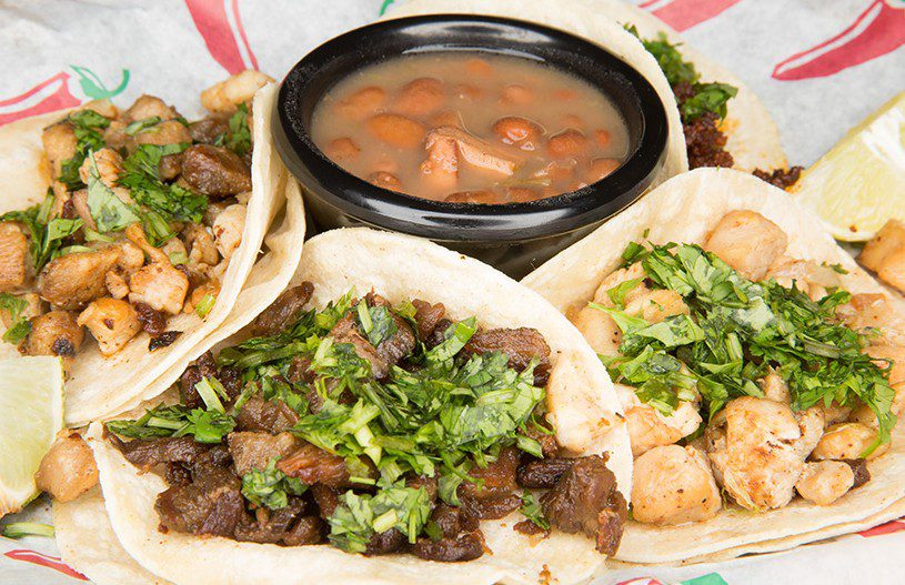 Street tacos are served with charro beans at Z's Taco Shop & Market. Photo by Brandon Scott.