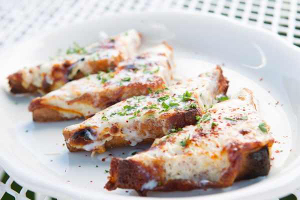 Cheesy crab toasts are a classic starter at R&J Lounge and Supper Club. Below: Smoky Mac & Cheese. Photos by Brent Fuchs.