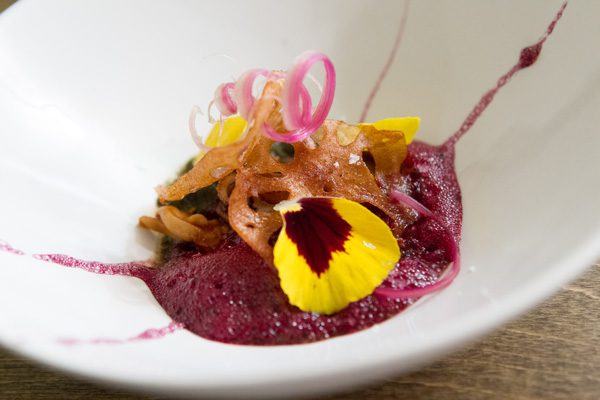 Squid is served on beet foam at Nani. Photo by Brent Fuchs.