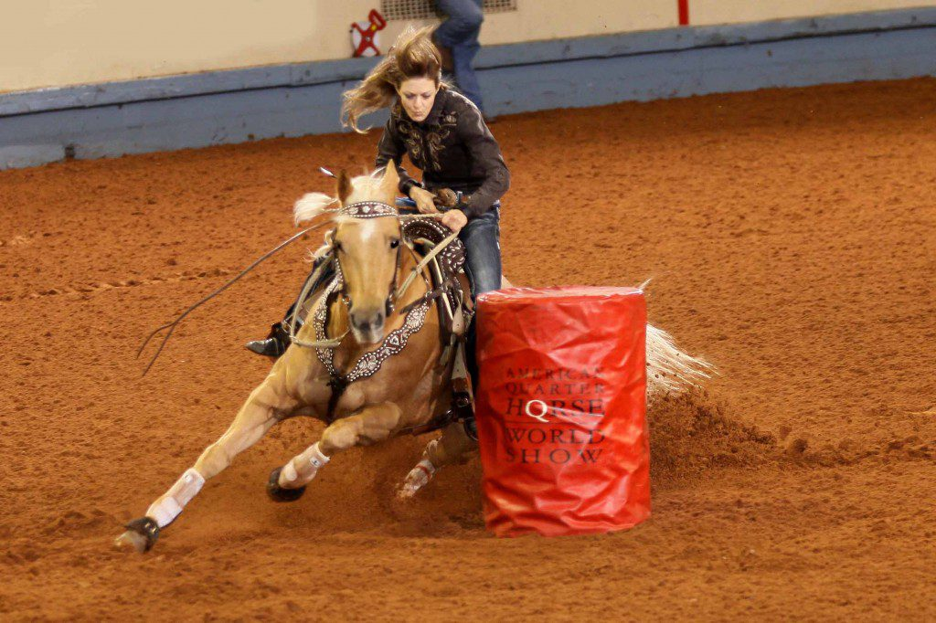 During her first trip to the AQHA World Championship Show, Jennifer Marie Arnold of Smyrna, Tennessee, captured the 2013 amateur barrel racing world championship with her mare Paris Firewater. The duo also set a record time for the class – :16.008 seconds. Photo courtesy AQHA.