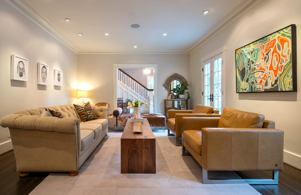 An existing sofa was used and new leather chairs purchased for the living area. Three pencil drawings by Tim Moore of rap stars are the conversation starters in the room.