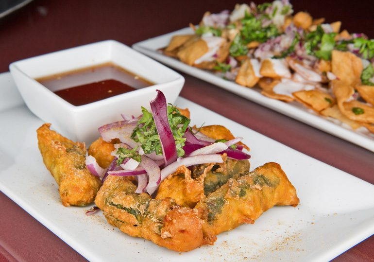 Flavorful chicken spinach rolls at cumin honor the tradition of indian cooking techniques and dishes straight from the home kitchen. Photo by Brandon Scott.