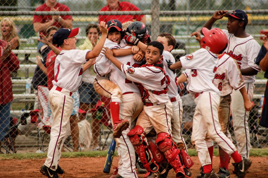 The Gulf Coast Cardinals celebrate a victory, Lake Jackson, Texas, 2009. Photo by Brenda Read Photography.