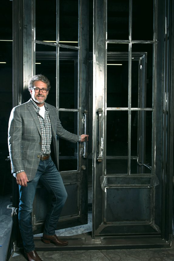 Designer Rob Key crafts doors, stair railings, balconies and gates from iron. Photos by Nathan Harmon.