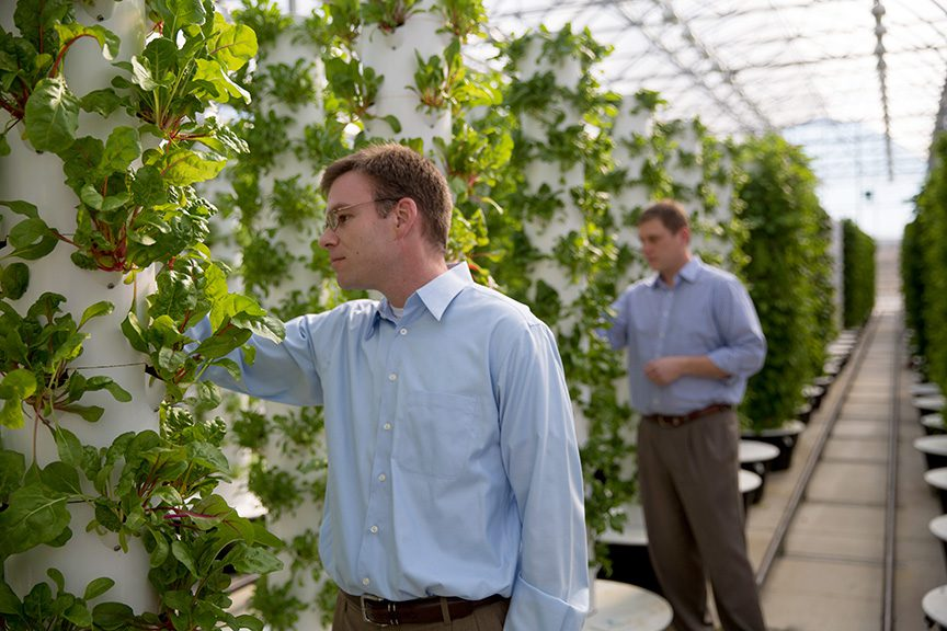 John Sulton , left, and Rob Walenta check on crops at Scissortail Farms, an aeroponic farm. Photo by Brandon Scott.