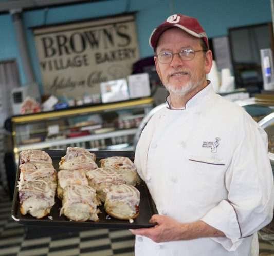 William Brown shows off some of Brown bakery's famous cinnamon rolls that come covered in just the right amount of icing. Photos by Brent Fuchs.