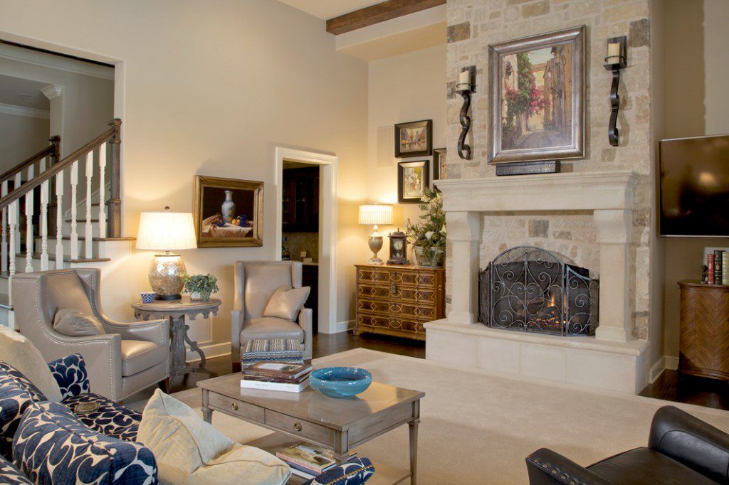 Taupe leather wingback chairs, a sofa and blue leather lounge chair create a cozy seating area around the room's fireplace. Photos by Rick Stiller.