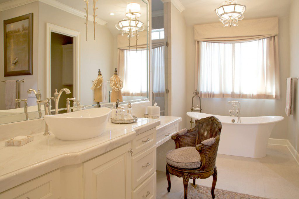 Limestone flooring and the freestanding tub keep the space feeling light and airy.