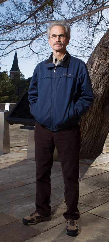 Dennis Purifoy, who survived the blast, stands next to the Survivor Tree, located on the grounds of the Oklahoma City National Memorial & Museum.