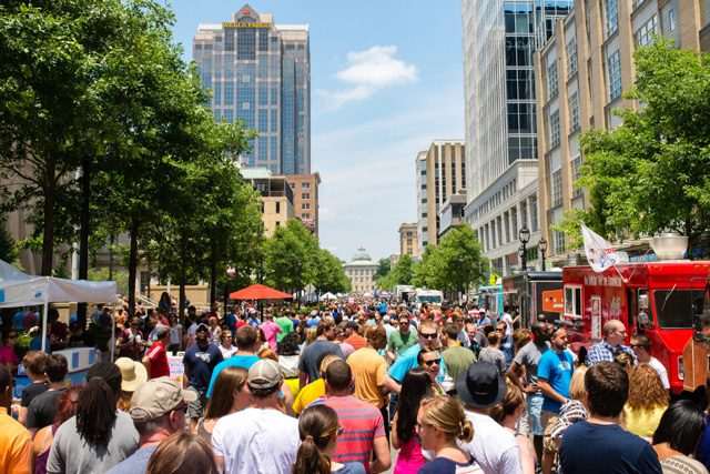 Crowds enjoy food trucks and fun along the happening Fayetteville street.