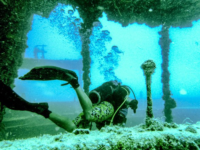 A diver explores the deck of the Thunderbolt – a 188-foot ship sunk in 1986 to create this dive spot 120 feet beneath the surface. photos by Viuf Photography.