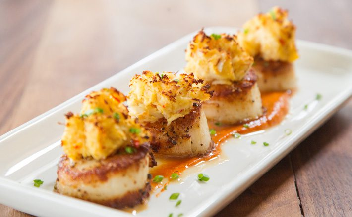 Stuffed scallops with red pepper coulis is among the seafood selections at Broadway 10. Photos by Brent Fuchs.