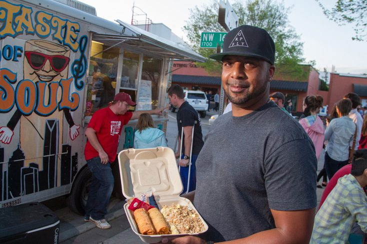 Co-owner Ricki Bly displays a meal from Taste of Soul Egg Roll. Photo by Brent Fuchs.