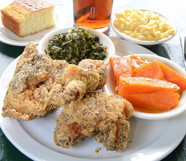 Fried chicken, collard greens, sweet potatoes, cornbread and mac n cheese is perfect served with iced tea at Evelyn's. Photo by Natalie Green.