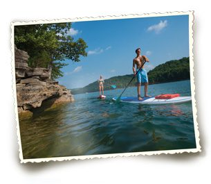 Visitors of Beaver Lake enjoy a day on the water with paddleboards.  Photo courtesy Arkansas department of Parks and tourism.