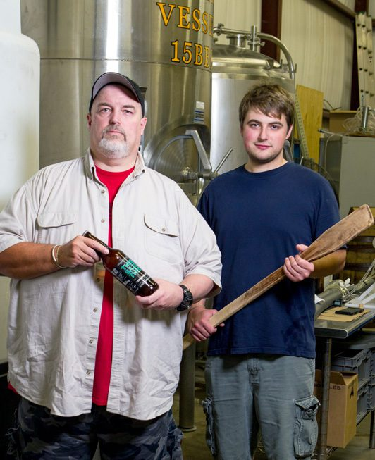 Mike Sandefur, pictured with his son, Jordan, is owner and brewmaster of battered boar. Photo by Brent Fuchs.