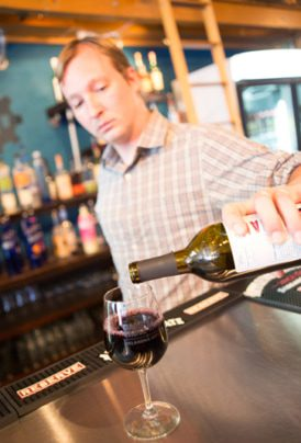 One of Urban Wineworks' experienced bartenders pours a glass of wine. photos by Brent Fuchs.