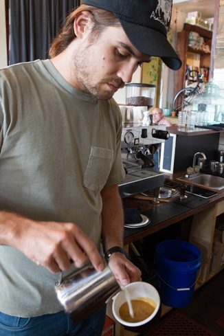 Hoboken Co-owner Trey woods prepares a latte.