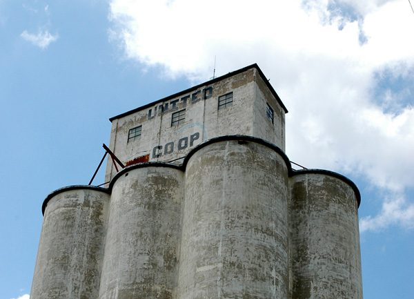 A grain elevator in Oklahoma, which has lost its original paint, shows its age.