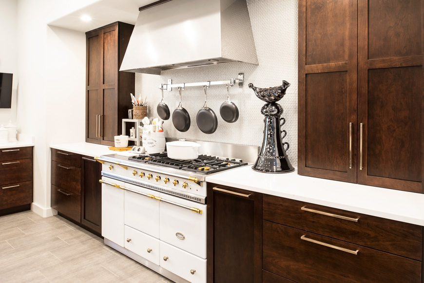 The Lacanche range was manufactured in France and is identical to one that was in the owner's previous home. The counter-to-ceiling cabinets flanking the stove are the only upper cabinetry in the room, designed by Kitchen Ideas. Photo by Melissa Lukenbaugh.