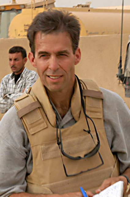 Rick Atkinson pictured here on assignment in Iraq, will recieve the Peggy v. Helmerich Distinguished Author Award on Dec. 5. Photo Courtesy of Tulsa Library Trust.