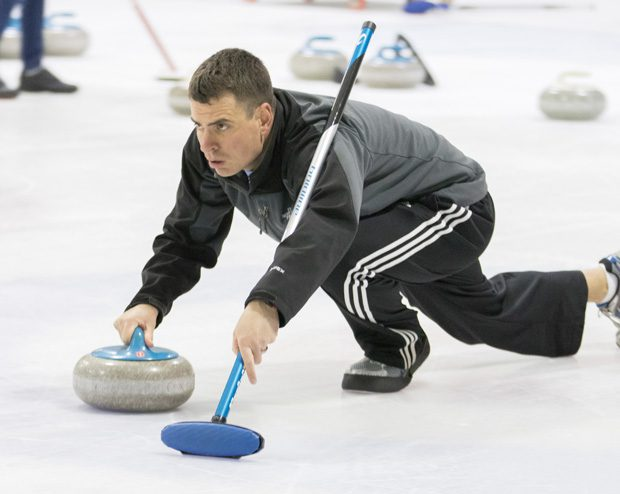 Keith Hudson sends his stone down the ice at a recent gathering of the Oklahoma Curling Club. Photo by Brent Fuchs.