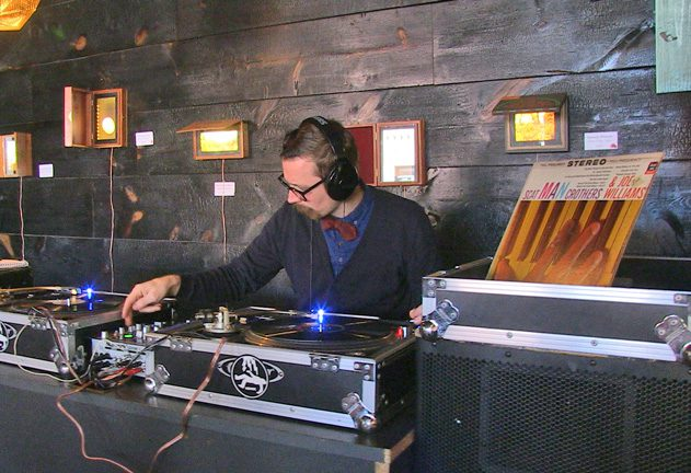 dj evan thomas spins one of the community's favorite vinyl records at Chimera cafe.