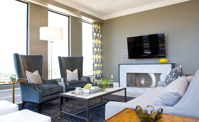 The focal point of the living room, the eco-friendly fireplace was custom-designed for the condo and faced in marble.