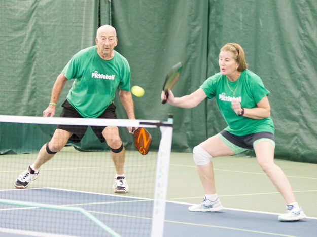 Couple enjoys a game of pickleball. Photo by Brent Fuchs.