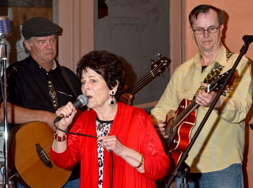 Ramona Reed performs with her son Jim Paul Blair (right). Also pictured is band member Bill Morgan. Photo by Dan Morgan.