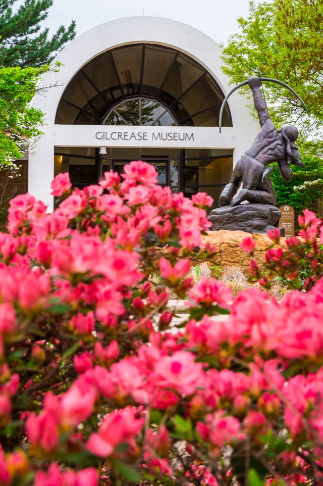 Spring azaleas bloom in front of the gilcrease museum.