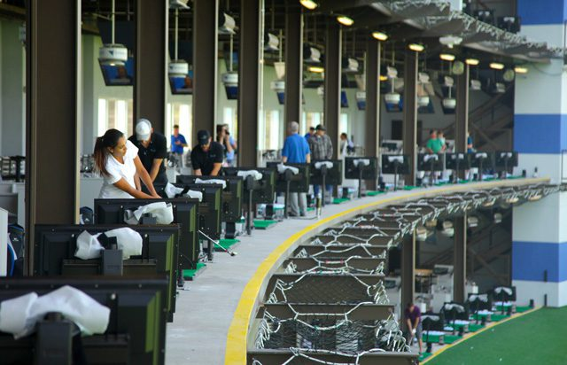 Visitors to the Flyingtee practice their golf game in the state-of-the-art building located inside the Jenks Riverwalk. Photos by Marc Rains.