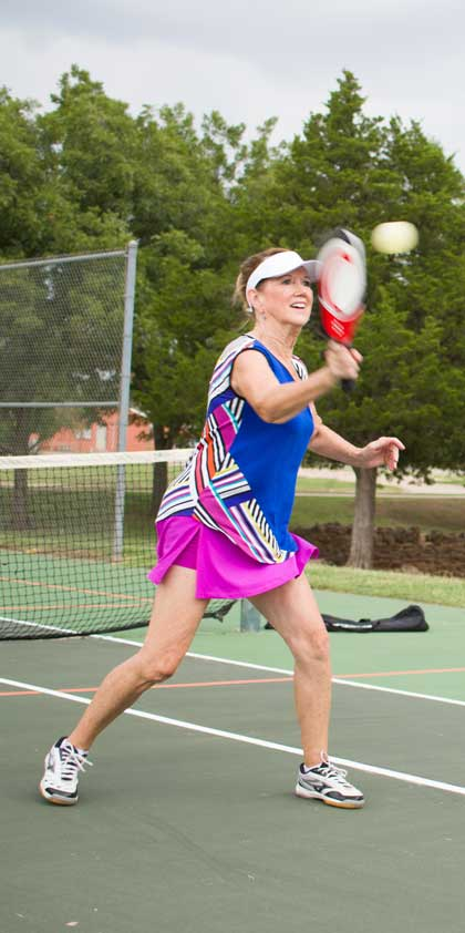 Barbara Mock of Edmond enjoys a game of pickleball, a sport that has helped keep her active. Photo by Brent Fuchs.