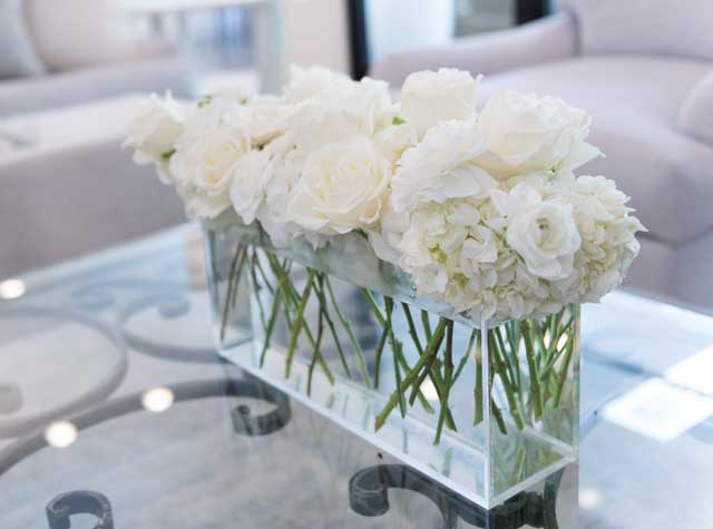"A quiet and calming style element, the ""tone-on-tone"" trend won't go out of style due to its sleek and timeless nature. Photo by Nathan Harmon. Flower arrangement by Toni's Flowers & Gifts."