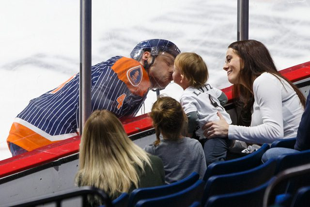 Oilers Defenseman Nathan Lutz interacts with his family. Photo by Kevin Pyle Photography.