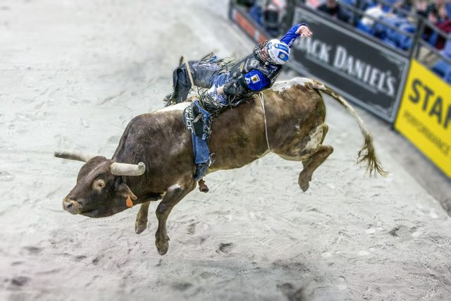 Ryan Dirteater rides during the championship round of the PBR BFTS Chicago Invitational.