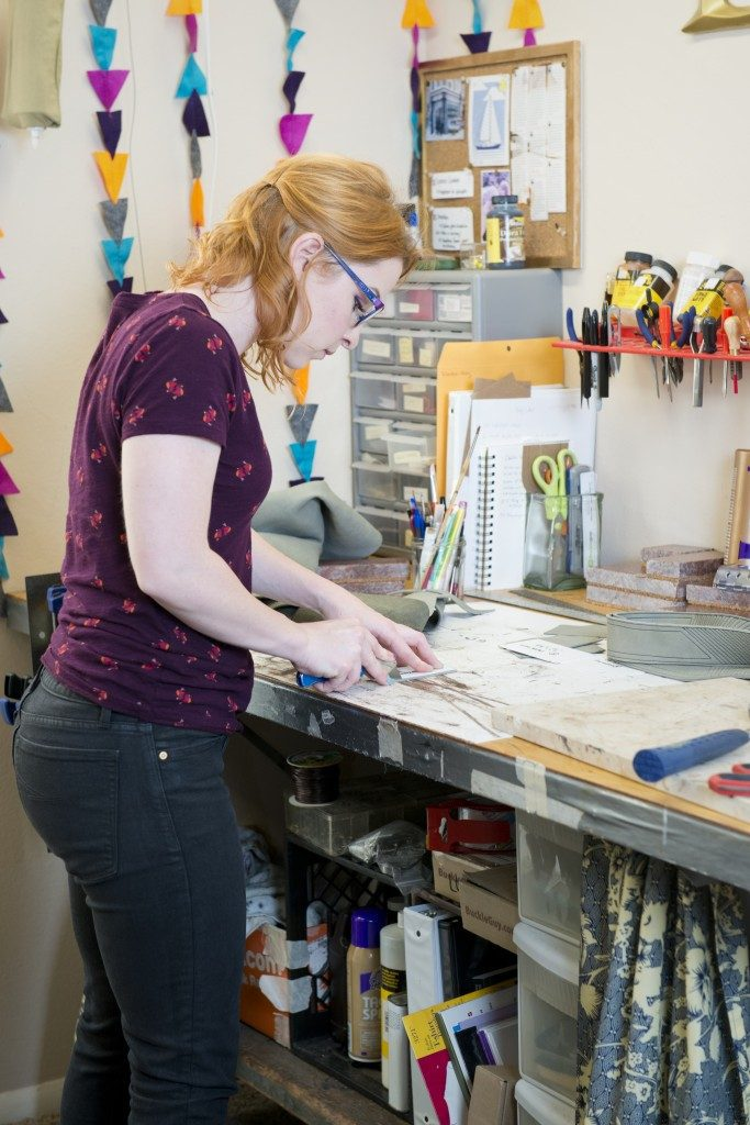Emily Blackburn carefully cuts leather for her customized creations. Photos by Natalie Green