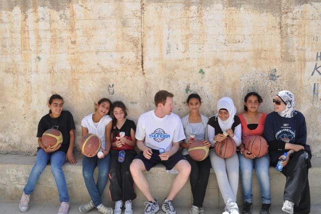 Sam Presti with a group of Palestinian girls with whom he worked as part of PeacePlayers International. Photo courtesy of the Oklahoma City Thunder.